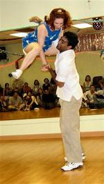 Nate helps partner Rachel perform an impressive aerial in a well-received Lindy Hop routine at the Ariel Dance Competition and Show event in San Jose, July 13, 2003
